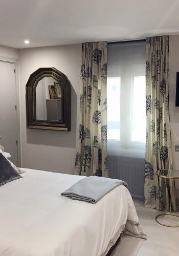 Dormitorio con interiorismo realizado por el estudio de interiores Libia Bárcenas